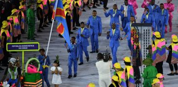 Democratic Republic of the Congo's flagbearer Rosa Keleku Lukusa leads her delegation during the opening ceremony of the Rio 2016 Olympic Games at the Maracana stadium in Rio de Janeiro on August 5, 2016. / AFP PHOTO / PEDRO UGARTE